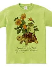 リクガメにまたがるカエル、ナスタチウムを噛む