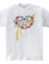 リボンとお花のハート型のリース。幸せをの鍵を運ぶ小鳥たち。